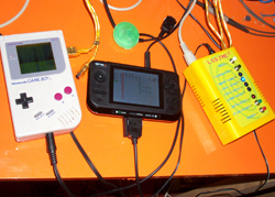 Firestarter's GP2x synchronized to a gameboy using a customized version of lsdjmc2